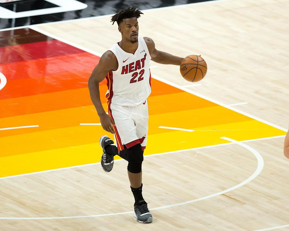 Feb 13, 2021; Salt Lake City, Utah, USA; Miami Heat forward Jimmy Butler (22) dribbles up the court against the Utah Jazz during the second half at Vivint Smart Home Arena.
