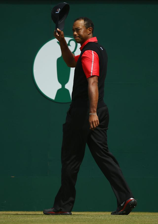 GULLANE, SCOTLAND - JULY 21: Tiger Woods of the United States waves to the crowd on the 1st tee during the final round of the 142nd Open Championship at Muirfield on July 21, 2013 in Gullane, Scotland. (Photo by Matthew Lewis/Getty Images)