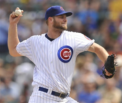 Chicago Cubs starter Chris Volstad delivers a pitch against the San Francisco Giants during the first inning during a baseball game in Chicago, Friday, Aug. 31, 2012. (AP Photo/Paul Beaty)
