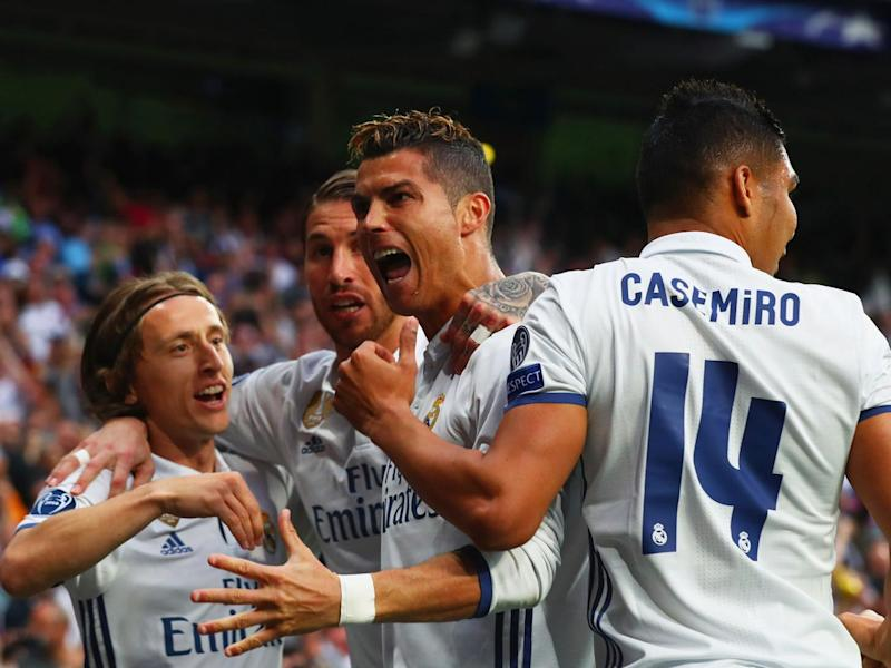 Ronaldo celebrates with team-mates after scoring his third (Getty)