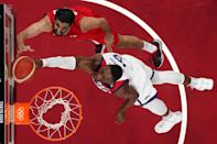 <p>USA's Edrice Femi Adebayo (R) goes to the basket past Iran's Mohammad Jamshidijafarabadi in the men's preliminary round group A basketball match between Iran and USA during the Tokyo 2020 Olympic Games at the Saitama Super Arena in Saitama on July 28, 2021. (Photo by Brian SNYDER / POOL / AFP)</p>