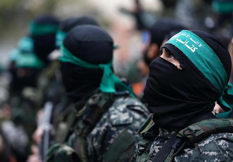 Palestinian Hamas militants attend a funeral procession in Gaza City on January 29, 2016 of seven Hamas militants who were killed after a tunnel built for fighting Israel collapsed in the Gaza Strip (AFP Photo/Mohammed Abed)