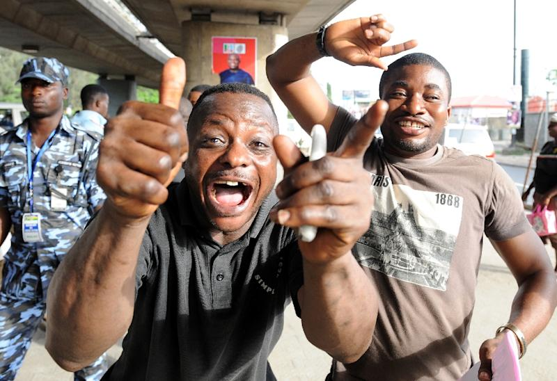 People celebrate after results of the gubernatorial and parliamentarian elections in Lagos, Nigeria, on April 11, 2015 (AFP Photo/Pius Utomi Ekpei)