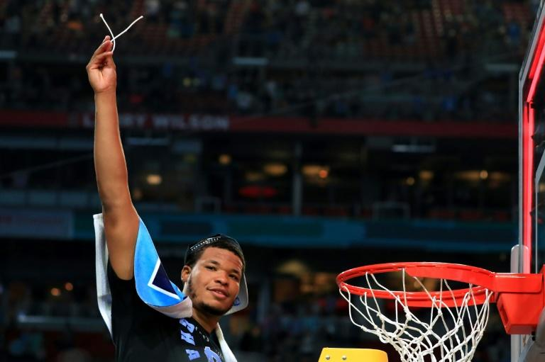 Kennedy Meeks of the North Carolina Tar Heels cuts off a piece from the net after defeating the Gonzaga Bulldogs during the 2017 NCAA Men's Final Four National Championship game, at University of Phoenix Stadium in Glendale, Arizona, on April 3