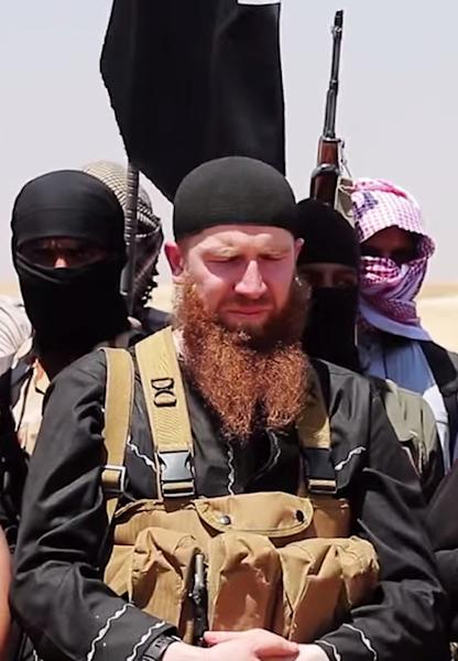 an image made available by Jihadist media outlet al-Itisam Media on June 29, 2014, allegedly showing members of the Islamic State (IS) group including military leader and Georgian native, Abu Omar al-Shishani (C) (AFP Photo/-)