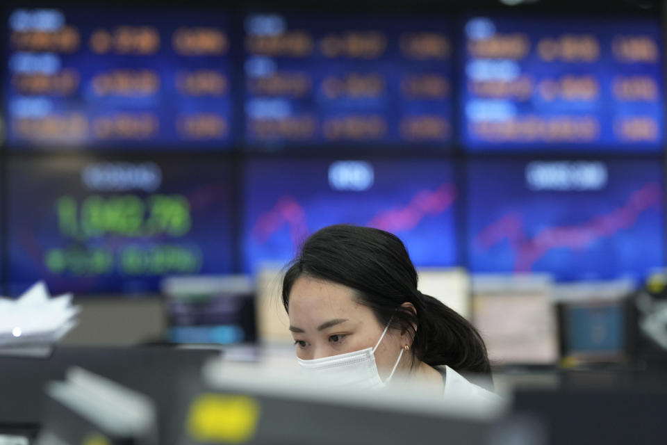 A currency trader watches monitors at the foreign exchange dealing room of the KEB Hana Bank headquarters in Seoul, South Korea, Thursday, Sept. 23, 2021. Asian shares were mostly higher on Thursday after the Federal Reserve signaled it may begin easing its extraordinary support measures for the economy later this year. (AP Photo/Ahn Young-joon)