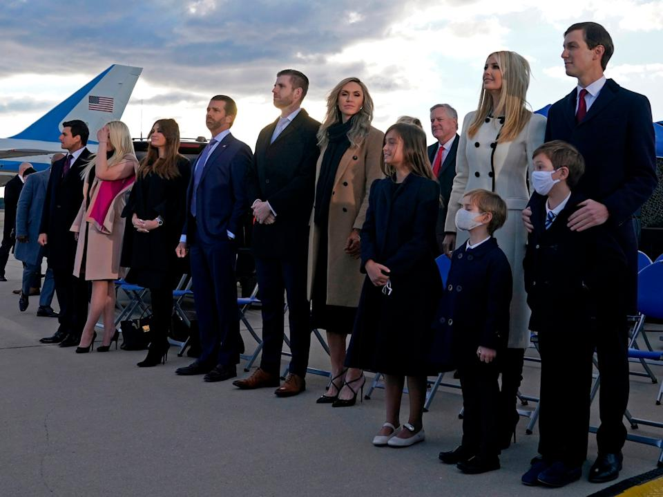 Ivanka Trump, Eric Trump, Donald Trump Jr, and Tiffany Trump stand with their respective partners on the tarmac at Joint Base Andrews in Maryland as they arrive for Donald Trump's departure on 20 January 2021 (Alex Edelman/AFP/ Getty)