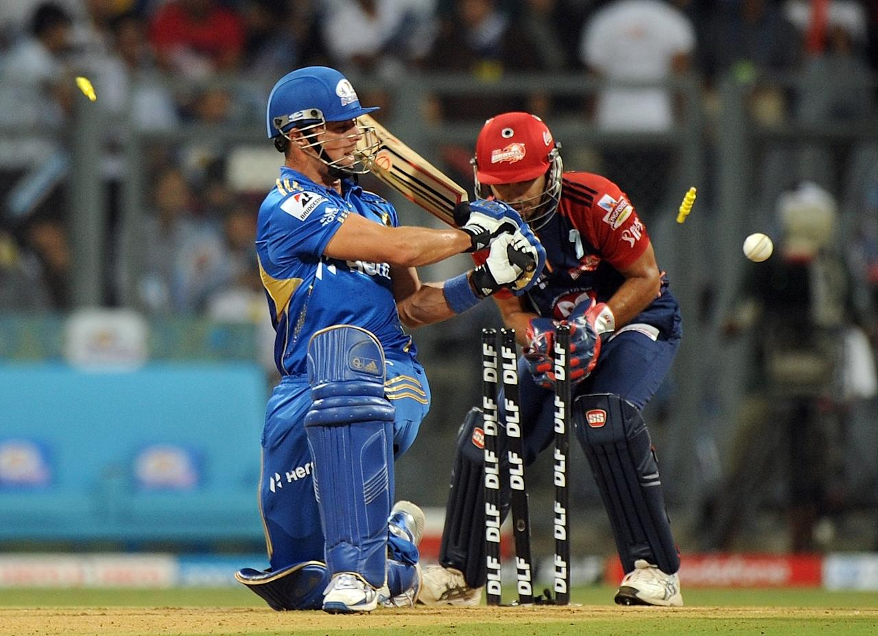 Mumbai Indians batsman Davy Jacobs (L) is clean bowled during the IPL Twenty20 cricket match between Mumbai Indians and Delhi Daredevils at the Wankhede Stadium in Mumbai on April 16, 2012.   RESTRICTED TO EDITORIAL USE. MOBILE USE WITHIN NEWS PACKAGE.    AFP PHOTO/Punit PARANJPE    (Photo credit should read PUNIT PARANJPE/AFP/Getty Images)