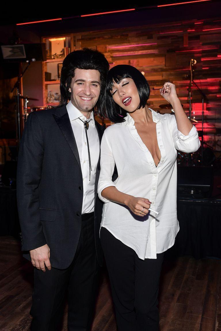 """<p>With the help of a bolo tie and a short bobbed wig, you can easily become <em>Pulp Fiction</em>'s Vincent and Mia (though you'll get bonus points if you perform their dance at a Halloween party).</p><p><a class=""""link rapid-noclick-resp"""" href=""""https://www.amazon.com/Handmade-Round-Shape-Western-Cowboy/dp/B06Y62JVZ1?tag=syn-yahoo-20&ascsubtag=%5Bartid%7C10070.g.2683%5Bsrc%7Cyahoo-us"""" rel=""""nofollow noopener"""" target=""""_blank"""" data-ylk=""""slk:SHOP BOLO TIE"""">SHOP BOLO TIE</a></p><p><a class=""""link rapid-noclick-resp"""" href=""""https://www.amazon.com/AGPtEK-Straight-Resistant-Short-Cosplay/dp/B00QLZQW4G?tag=syn-yahoo-20&ascsubtag=%5Bartid%7C10070.g.2683%5Bsrc%7Cyahoo-us"""" rel=""""nofollow noopener"""" target=""""_blank"""" data-ylk=""""slk:SHOP BOBBED WIG"""">SHOP BOBBED WIG</a></p>"""