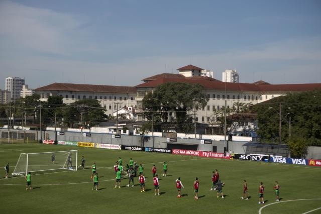 Mexico's national soccer team players train during a practice session in Santos, Brazil, Sunday, June 8, 2014. Mexico play in group A of the 2014 soccer World Cup. (AP Photo/Eduardo Verdugo)