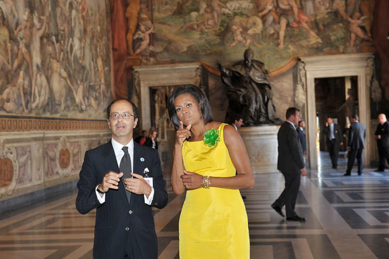 Michelle Obama visits the Capitole Hill in a chartreuse Wu. (Photo: Getty)