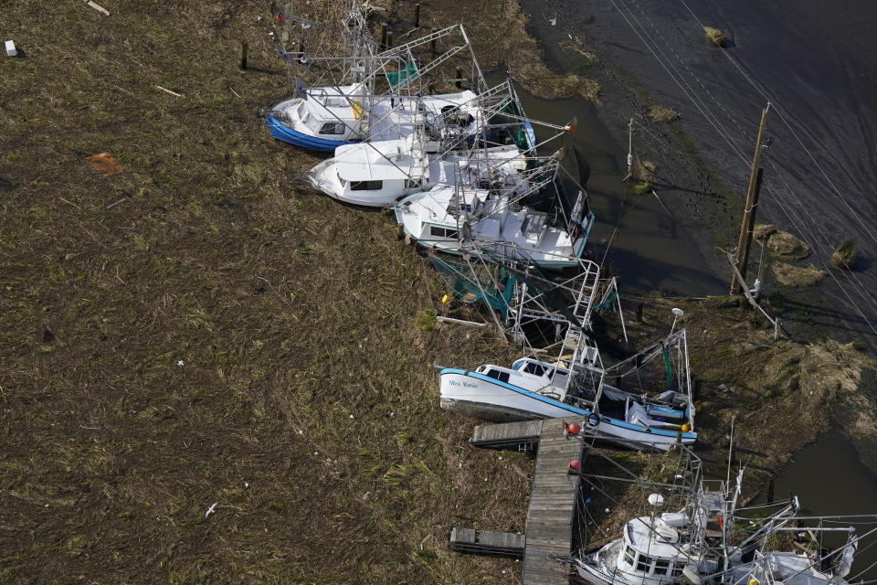 Boats are seen lying on the earth in the aftermath of Hurricane Ida, Monday, Aug. 30, 2021, in Lafitte, La.  The weather died down shortly before dawn. (David J. Phillip/AP Photo)