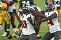 FILE - In this Oct. 18, 2020, file photo, Tampa Bay Buccaneers outside linebacker Jason Pierre-Paul (90) and inside linebacker Lavonte David (54) celebrate after sacking Green Bay Packers quarterback Aaron Rodgers (12) during the second half of an NFL football game in Tampa, Fla. This has been a year for sports in Tampa like few other, though the city and the teams' have had a chance to truly capitalize on the boom and energize the disinterested and sometimes downright apathic fan bases. It has been — and continues to be —- a missed opportunity. (AP Photo/Mark LoMoglio, File)