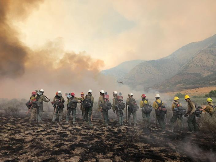 "Firefighters battle the Pine Gulch Fire in the Eagle Valley Wildland. <p class=""copyright"">Pine Gulch Fire Information Team/Facebook</p>"