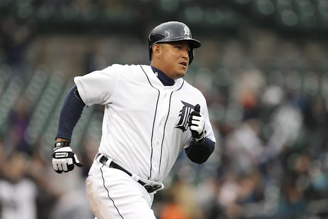 Detroit Tigers' Miguel Cabrera runs the bases after hitting a two-run home run against the Baltimore Orioles in the eighth inning of a baseball game in Detroit, Friday, April 4, 2014. (AP Photo/Paul Sancya)