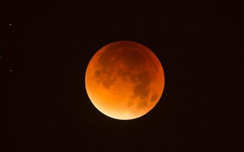 The Moon can turn yellow, orange, red of even black during an eclipse - Credit:  Eddie Mulholland