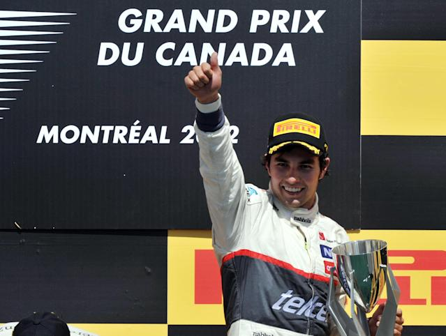 Third place finisher Sauber Ferrari driver Sergio Perez of Mexico holds up the trophy on the podium after the Canadian Formula One Grand Prix on June 10, 2012 at the Circuit Gilles Villeneuve in Montreal. AFP PHOTO/Stan HONDASTAN HONDA/AFP/GettyImages