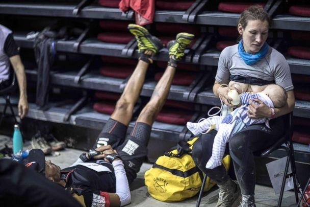 PHOTO: Great-Britain's trail runner Sophie Power breastfeeds her three months old baby Cormac during a break as she competes in the 105 mile Mount Blanc Ultra Trail (UTMB) race, Aug. 31, 2018, in Courmayeur, Italy. (Alexis Berg/AFP/Getty Images)