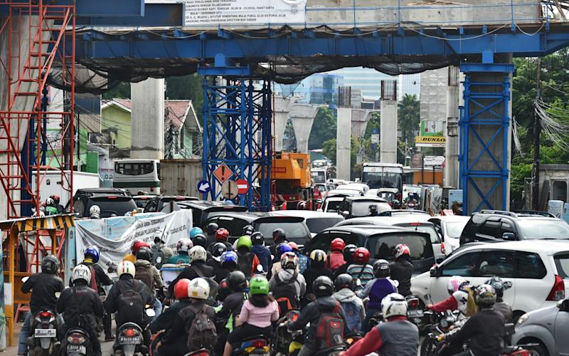 Indonesia lacks a mass-transport system, forcing its increasingly affluent 250 million people to rely heavily on private transport - Credit: AFP