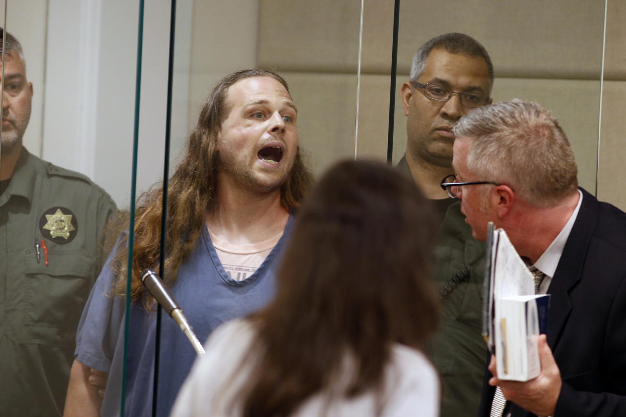 <p>Jeremy Joseph Christian shouts as he is arraigned in Multnomah County Circuit Court in Portland, Ore., Tuesday, May 30, 2017. (Beth Nakamura/The Oregonian via AP, Pool) </p>