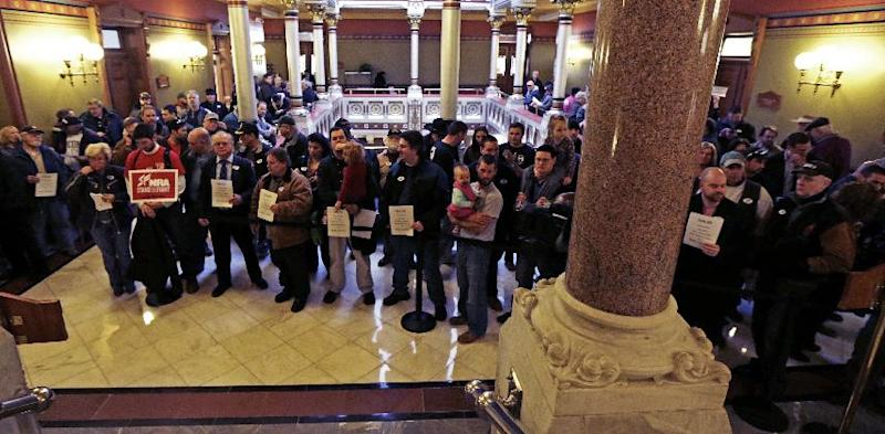 Gun rights advocates fill the hallways of the Capitol in Hartford, Conn., Wednesday, April 3, 2013. Hundreds of gun rights advocates are gathering at the statehouse in Hartford ahead of a vote in the General Assembly on proposed gun-control legislation. (AP Photo/Charles Krupa)