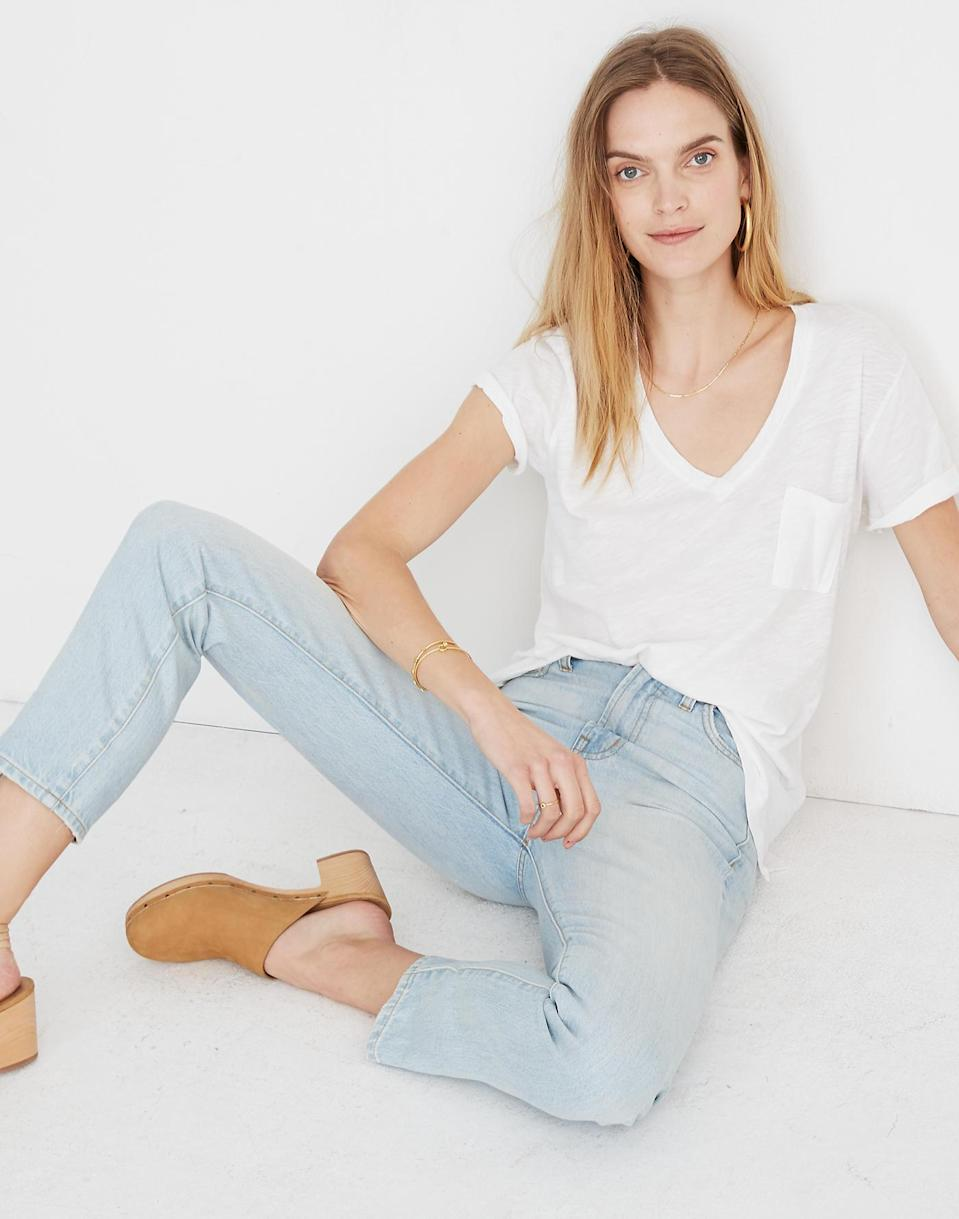 """The lightweight material of this tee makes it perfect for a casual French tuck into your jeans (if you're <a href=""""https://www.glamour.com/story/comfortable-jeans-quarantine?mbid=synd_yahoo_rss"""" rel=""""nofollow noopener"""" target=""""_blank"""" data-ylk=""""slk:wearing them in quarantine"""" class=""""link rapid-noclick-resp"""">wearing them in quarantine</a>). $20, Madewell. <a href=""""https://www.madewell.com/whisper-cotton-v-neck-pocket-tee-G9092.html"""" rel=""""nofollow noopener"""" target=""""_blank"""" data-ylk=""""slk:Get it now!"""" class=""""link rapid-noclick-resp"""">Get it now!</a>"""