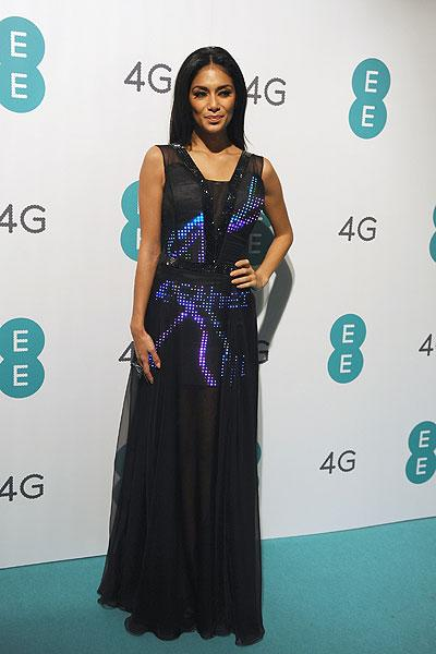 Pussycat Dolls star and 'X Factor UK' judge Nicole Scherzinger is leading the way in social media by using her best assets: Her amazing sense of style! The 34-year-old singer modeled the UK's first Twitter dress at the launch of EE, Britain's first 4G mobile network on Nov. 1 in London, England. (Photo by Ferdaus Shamim/WireImage)