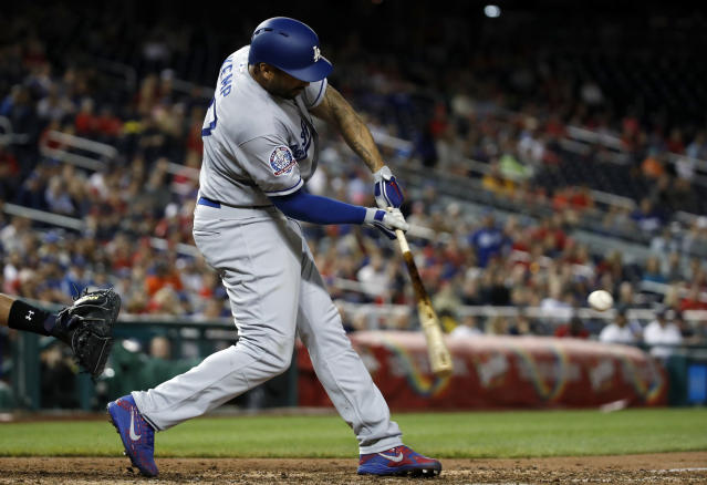 Los Angeles Dodgers' Matt Kemp hits a two-RBI double during the ninth inning of the second baseball game of a doubleheader against the Washington Nationals at Nationals Park, Saturday, May 19, 2018, in Washington. (AP Photo/Alex Brandon)