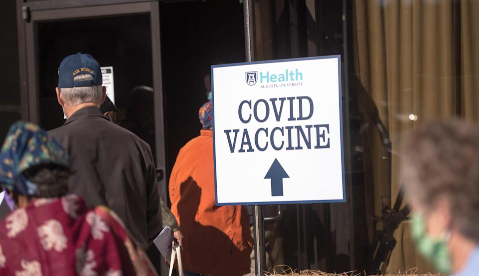 People line up for COVID-19 vaccinations on Thursday at Warren Baptist Church in Augusta, Ga.