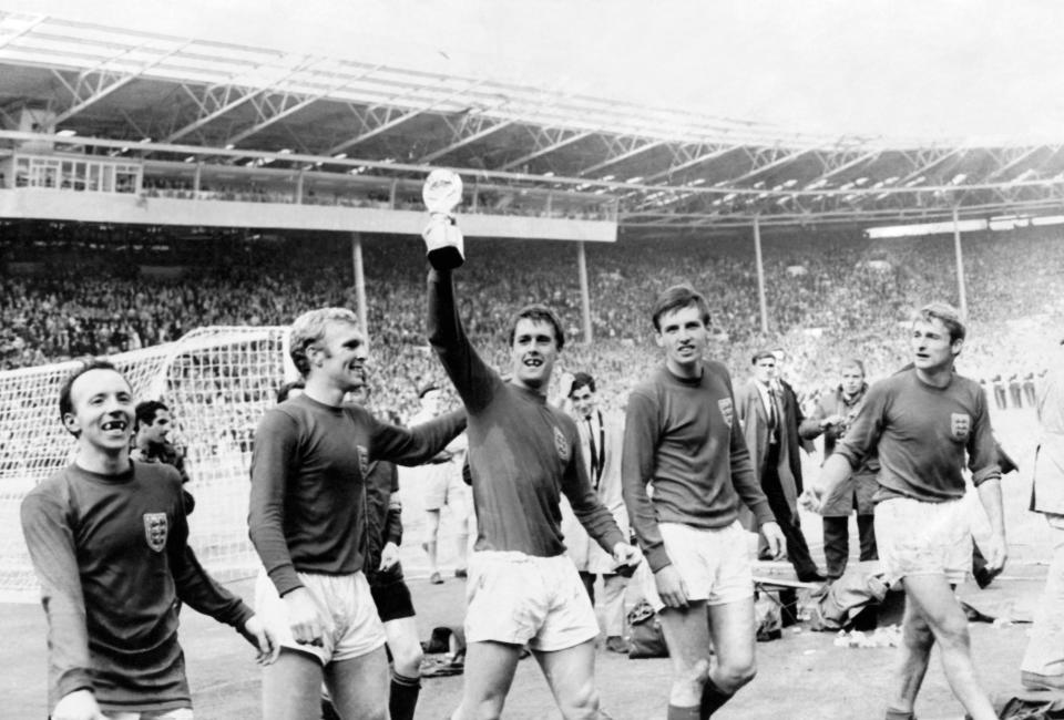 England 4 v West Germany 2 after extra time. Geoff Hurst holds aloft the World Cup trophy joined by teammates (left to right) Nobby Stiles, Bobby Moore, Martin Peters and Roger Hunt on a lap of honour around the Stadium after the match. 30th July 1966. (Photo by Daily Mirror/Mirrorpix/Mirrorpix via Getty Images)
