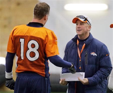 Denver Broncos quarterback Peyton Manning (L) talks with head coach John Fox during their practice session for the Super Bowl at the New York Jets Training Center in Florham Park, New Jersey January 30, 2014. REUTERS/Ray Stubblebine