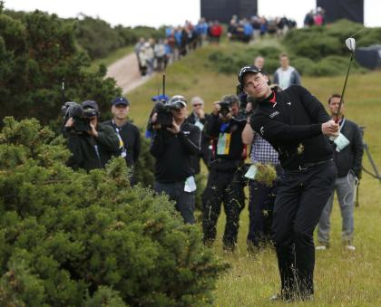 Danny Willett hits onto the sixth green during the second round of the British Open. (REUTERS)
