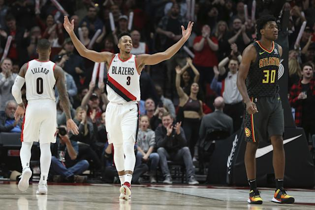 Portland Trail Blazers guard CJ McCollum reacts after making a 3-point basket during overtime of an NBA basketball game in Portland, Ore., Sunday, Nov. 10, 2019. The Blazers won 124-113. (AP Photo/Craig Mitchelldyer)