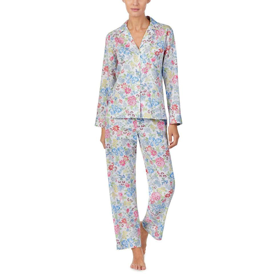 """<p><strong>Lauren Ralph Lauren</strong></p><p>macys.com</p><p><strong>$56.00</strong></p><p><a href=""""https://go.redirectingat.com?id=74968X1596630&url=https%3A%2F%2Fwww.macys.com%2Fshop%2Fproduct%2Flauren-ralph-lauren-printed-pajama-set%3FID%3D10513385&sref=https%3A%2F%2Fwww.housebeautiful.com%2Fshopping%2Fg31669523%2Fchic-pajama-sets%2F"""" rel=""""nofollow noopener"""" target=""""_blank"""" data-ylk=""""slk:Shop Now"""" class=""""link rapid-noclick-resp"""">Shop Now</a></p><p>If you don't have a garden of your own, make do with a colorful floral PJ set like this. </p>"""