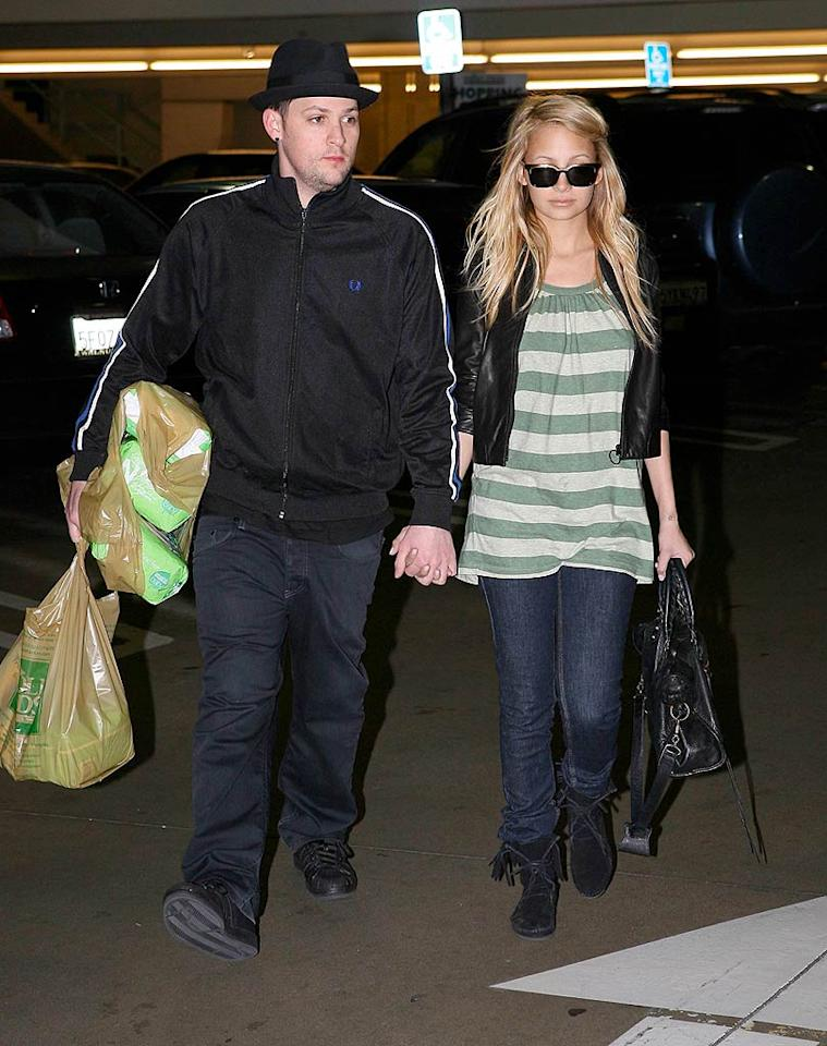 "On Tuesday, new parents Joel Madden and Nicole Richie picked up some eco-friendly diapers at Whole Foods for their baby girl, Harlow Winter. AlphaX/<a href=""http://www.x17online.com"" target=""new"">X17 Online</a> - February 4, 2008"