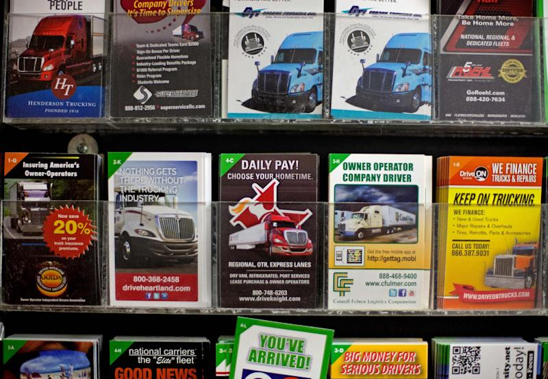 Cards advertising truck driving opportunities stand on display at a truck stop Tuesday, Oct. 30, 2012, in Atlanta. Even amid a struggling economy with high unemployment, trucking companies had a tough time hiring young drivers willing to hit the road for long hauls. Now the U.S. is speeding toward a critical shortage of truck drivers in the next few years as the economy recovers and demand for goods increases, an expert in the inner-workings of supply chains said in a report Tuesday. (AP Photo/David Goldman)