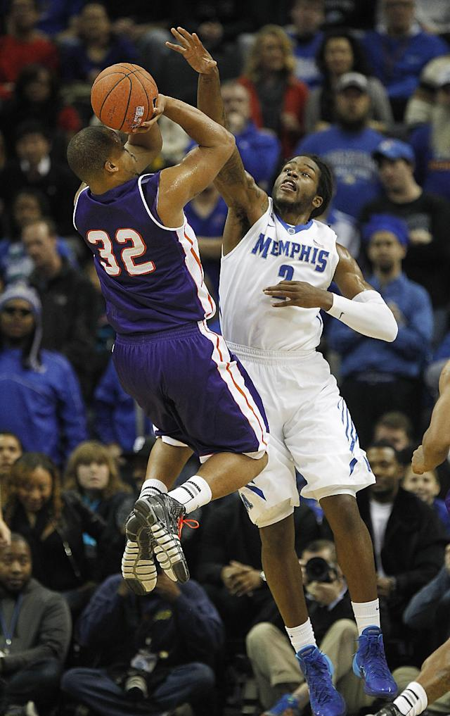 Memphis forward Shaq Goodwin (2) tries to block a shot by Northwestern State forward Dequan Hicks (32) in the first half of an NCAA college basketball game on Saturday, Dec. 7, 2013, in Memphis, Tenn. (AP Photo/Lance Murphey)