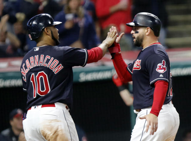 Cleveland Indians' Edwin Encarnacion (10) and Yonder Alonso celebrate scoring on a hit by Melky Cabrera in the fourth inning of a baseball game against the Boston Red Sox, Sunday, Sept. 23, 2018, in Cleveland. (AP Photo/Tom E. Puskar)