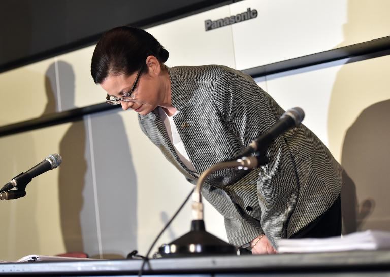 McDonald's Japan president Sarah Casanova bows her head as she announces the company's restructuring plan at a press conference at the Tokyo Stock Exchange on April 16, 2015