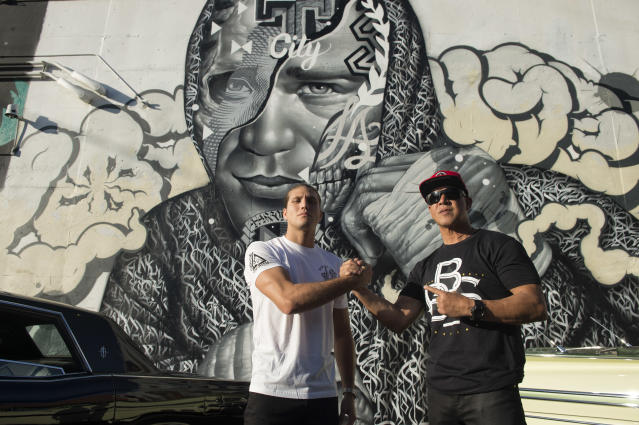 UFC featherweight Brian Ortega and his coach James Luhrsen in front of a mural of Ortega created by artists Tristan Eaton, Richard Wyrgatsch II and Alex Kizu in Los Angeles on Nov 5, 2018. (Getty Images)