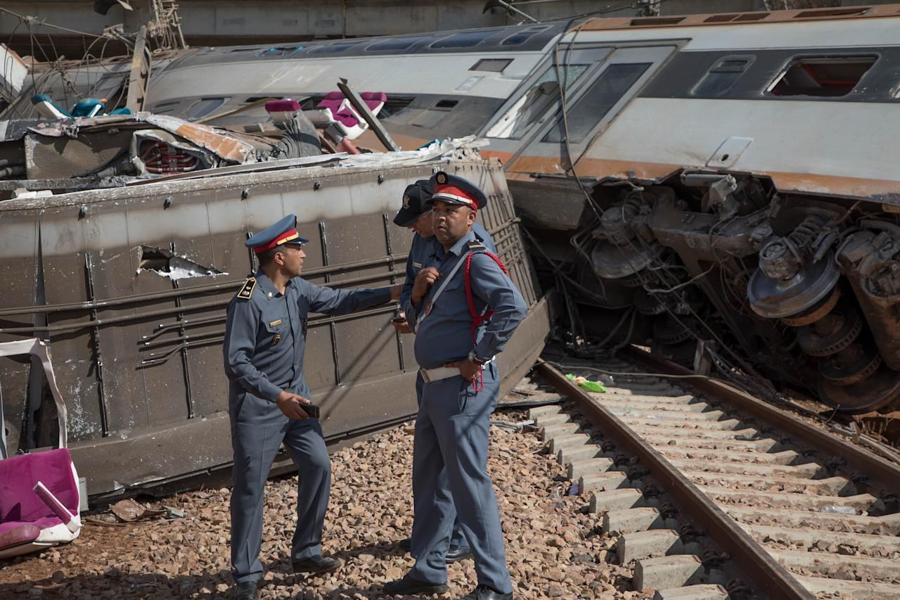 <p>Police officers inspect the area after a train derailed in the town of Sidi Bouknadel between Rabat and the northwestern city of Kenitra in Morocco on Oct. 16, 2018. (Photo: Jalal Morchidi/Anadolu Agency/Getty Images) </p>