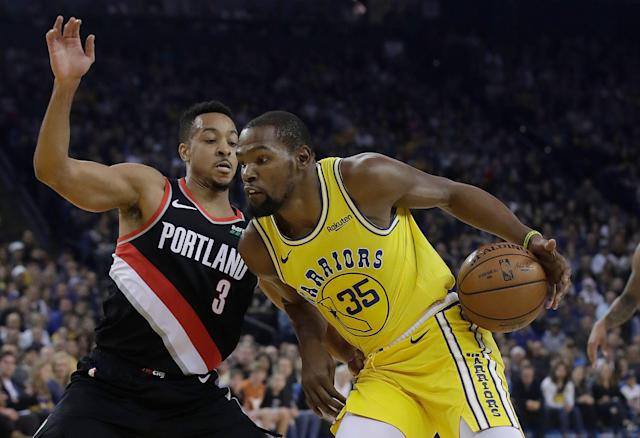Portland guard CJ McCollum will get a chance to redeem himself against Warriors forward Kevin Durant. (AP Photo/Jeff Chiu)
