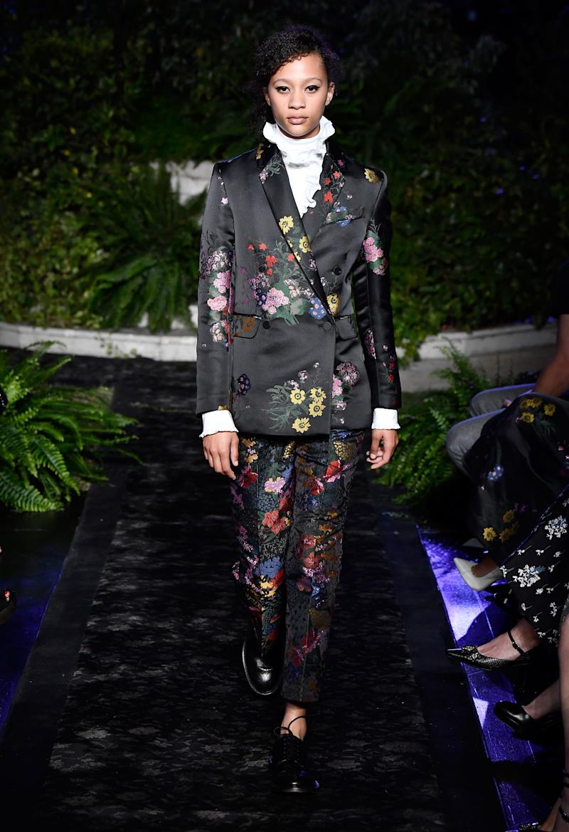 Model wears floral printed suit from Erdem x H&M collection. (Photo: Getty)