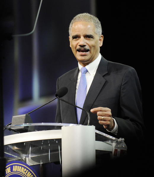 Attorney General Eric Holder speaks at the NAACP annual convention Tuesday, July 10, 2012, in Houston. Holder says he opposes a new photo ID requirement in Texas elections because it would be harmful to minority voters. (AP Photo/Pat Sullivan)