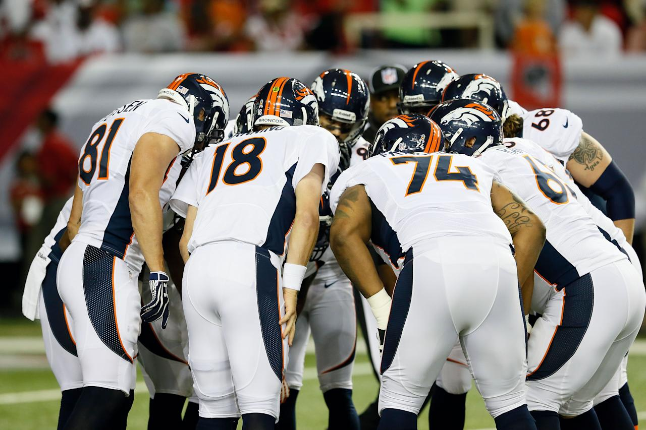 ATLANTA, GA - SEPTEMBER 17:  Quarterback Peyton Manning #18 of the Denver Broncos calls a play in the huddle against the Atlanta Falcons during their game at the Georgia Dome on September 17, 2012 in Atlanta, Georgia.  (Photo by Kevin C. Cox/Getty Images)