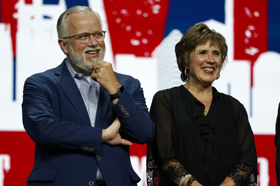 FILE - In this Wednesday, June 16, 2021 file photo, incoming Southern Baptist Convention President Ed Litton, left, and his wife, Kathy Litton, attend the annual Southern Baptist Convention meeting in Nashville, Tenn. Litton assumed his new role amid division in the convention over its future as well as issues of race, the role of women in the church and how to address sexual abuse in the church. (AP Photo/Mark Humphrey, File)