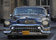 A man sits in his U.S. made 1955 Cadillac in Havana August 2, 2010. REUTERS/Desmond Boylan (CUBA - Tags: SOCIETY TRANSPORT)