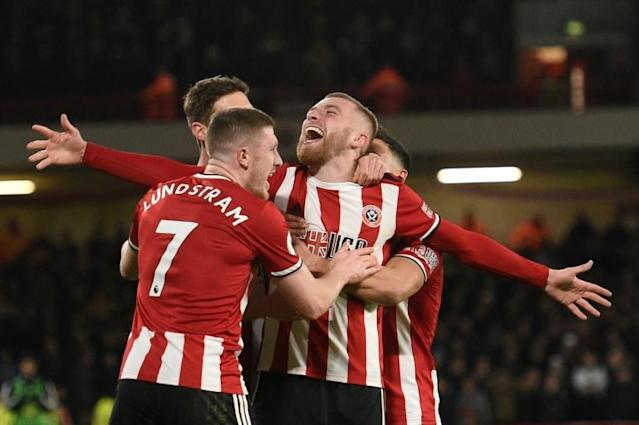 Buoyant Blades: Sheffield United are seventh in their first season back in the top flight (AFP Photo/Oli SCARFF )
