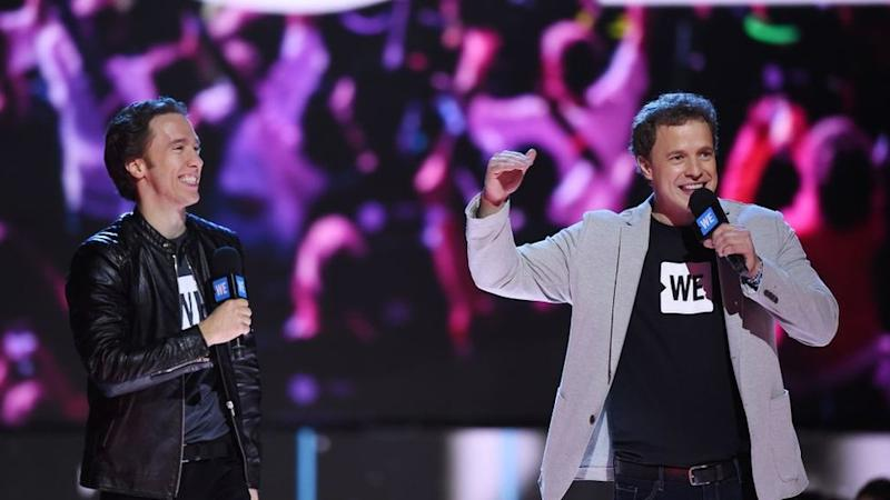 WE co-founders Craig Kielburger and Marc Kielburger speak on stage at WE Day California, April 27, 2017