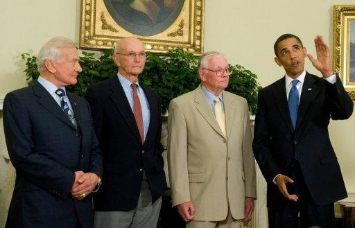 "US President Barack Obama talks with the first man on the moon Neil Armstrong (2nd R), and fellow Apollo 11 crewmembers Edwin ""Buzz"" Aldrin (L) and Michael Collins at the White House on the 40th anniversary of the first human landing on the moon, July 20, 2009. Armstrong has died following complications from cardiovascular surgery. He was 82"